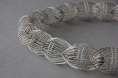Wire necklace by wire artist Ines Schwotzer of Germany. Unfortunately I couldn't find much info on her technique online in English. More at http://www.schwotzer-design.de/Webcard/Kl/ENG/klfr.htm