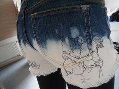 DIY jeans shorts, Peter Pan themed. Cut, bleach, fray, draw.
