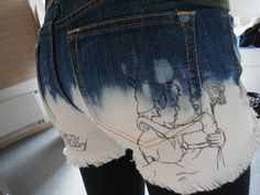 DIY jeans shorts, Peter Pan themed. Cut, bleach, fray, draw.