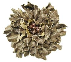 Bronze leather brooch