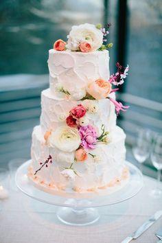 three tier peony topped wedding cake