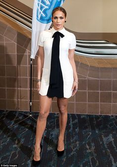 Fashion risk: Jennifer Lopez donned a masculine-inspired white frock and tie at the American Idol audition in New Orleans on Wednesday, fell...
