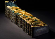 Artist Guy Laramée Carves a Mountainous Landscape from an Encyclopedia Britannica Set  See much more of this epic book landscape at the link:  http://www.thisiscolossal.com/2013/12/adieu-guy-laramee/