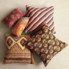 I love the Kantha Quilted Pillow on westelm.com  color+pattern makes me happy and if baby drops something on it it wont be highly visible. i gotta design with baby in mind.