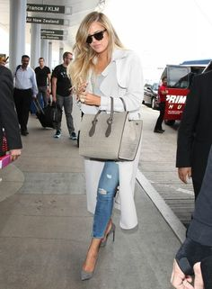 Reality star Khloe Kardashian departing on a flight at LAX airport in Los Angeles, Calfiornia on April 7, 2015. Rumors are swirling that Khloe is dating her on-again, off-again beau French Montana and her estranged husband Lamar Odom at the same time.