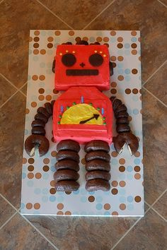 "Robot cake- this was Laurel's 3rd birthday cake. She was obsessed with robots! Fun and simple, I just ran across a pin of it and thought, ""hey! That's my cake! That's my cake board and my kitchen floor!"" Hah! http://www.enviee.com/blog/?p=73"