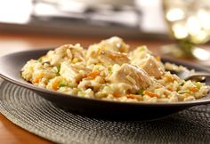 Simple Creamy Chicken Risotto. This main-dish risotto is chock full of chicken, carrots and green onion...it's creamy, delicious, and requires very little stirring.