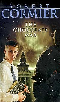 The Chocolate War by Robert Cormier. This YA book is often banned for teens because of its brilliant, unflinching portrait of vicious mob cruelty and conformity in an exclusive prep school. It is an intensely real and must-read book.