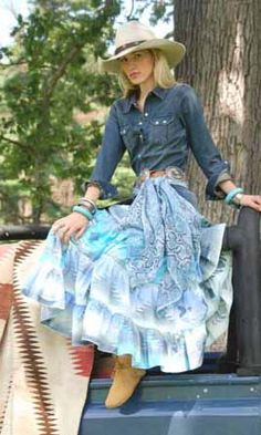 Not a huge fan of the boots, or scarf thing on the belt, but I love the full western skirt.
