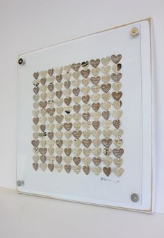 Hearts Guest Book     Create a work of art with your guest book. Have your guests sign paper hearts, and then you can make them into a stunning display of well wishes in your home.    Photo courtesy  Celadon Home .