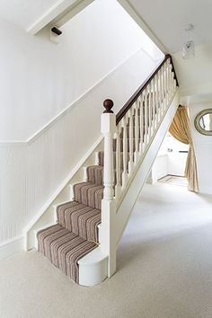 White painted stairs, newel & spindles.
