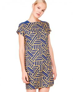 Short sleeve dress in 100% lightweight viscose livened up by geometric theme allover. Straight fit, round neck and above knee length. Opening at the back closed with invisible zip and solid fabric shoulder detail.