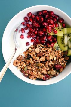 homemade granola for breakfast with kiwi and pomegranate
