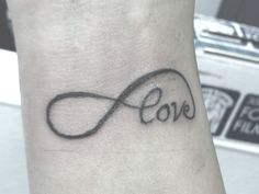 Love and Infinity sign are inked in the same tattoo. Description from slodive.com. I searched for this on bing.com/images