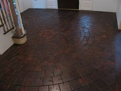 End grain pine blocks in a pinwheel pattern.  Installation by Floor Image, Inc.