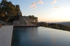 """And what would an ideabook on outdoor pools be without a zero-edge infinity pool? As the architects describe the pool, """"it was careful fit into the existing rocky landscape for total scenery immersion."""""""