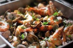 Roasted Seafood by Nigella... http://www.cookingchanneltv.com/recipes/nigella-lawson/roasted-seafood-recipe/index.html