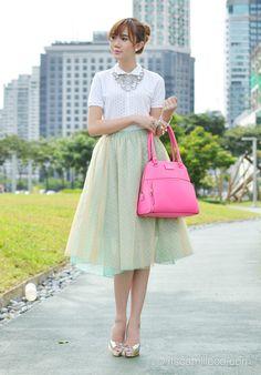 Polka dot top + tulle skirt + heels + charm bracelet + Kate Spade neon pink bag + statement necklace. So ladylike & sweet.