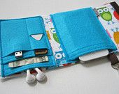 Nerd Herder gadget wallet in Songbird for iPod, Droid, iPhone, camera, earbuds, SD cards, USB, extra batteries, guitar picks,. $32.00, via Etsy.