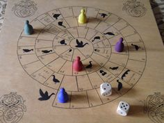 Ready. Set. Race! The Royal Game of Goose is a historical racing game popular in the 15th and 16th centuries. This hand crafted board include a complete rule book, 6 men and a set of wooden dice. This game is a lot of fun to play for children and adults alike. Careful of the trap squares like the well or the prison! This game is easy for kids and adults to learn.