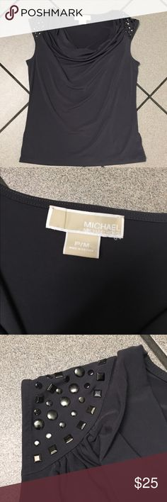 🐝Michael Kors Grey Top🐝 Gorgeous polyester top that's perfect for the office or pair with jeans for a lunch with the girls. Embellished cap sleeves for some flair (no missing embellishments) and a draped neck line. Small snag (fourth picture) on the lower front. I'm only looking to sell at this time so sorry but no trades. My listing price is firm unless bundled. Michael Kors Tops