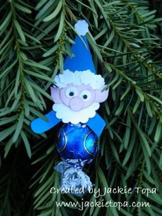 Lindor Elves--------punches I used: Hat: pennant punch, Fur & Nose: Itty Bitty Punch Pack, Ears: Merry Minis Ornament, Eyes: Owl Builder, Arms: Word Window, Head: Small Oval, Collar: Small Scallop Circle.     Tip: Punch two scalloped circles and staple them on either side of one of the cellophane tails. The head will hide the staple and the chocolate will be held securely in place.