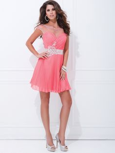 The soft and pretty look of this Tony Bowls prom dress is appropriate for prom or other formal event. This chiffon Tony Bowls Shorts TS11461 prom dress features a sheer high neckline with cap sleeves, wrap ruched bodice, and delicate waistband adorned with sparkly crystals. The sexy open back adds a perfect finishing touch to this Tony Bowls prom dress. Completing this Tony Bowls prom dress is a short pleated skirt. This stylish and affordable Tony Bowls Shorts prom dress is a great choice…