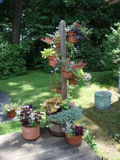 Garden designs. Good idea it could be done on the corners of a patio with hanging lights.
