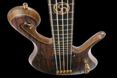 The custom bass guitar body from the top with fretboard inlays, Bartolini pickups, scroll and Hipshot hardware