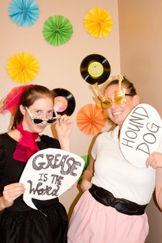 Our 50's themed photo booth with DIY 50's Rock n'Roll signs