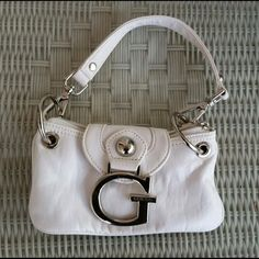 Small guess hand bag Small white guess hand bag. Excellent condition Guess Bags Mini Bags