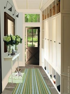 I like the idea of doors to hide whatever's stored, instead of doing the usual exposed hooks.