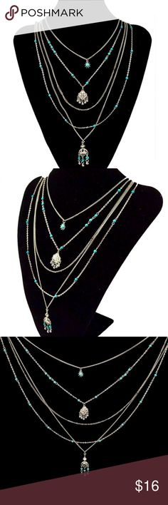 """5 Layer Multi Chain Boho Turquoise Silver Charm Stunning NWT five layer tassel pendant necklace with beautiful faux turquoise stone embellishment, and silver-tone chains and charms.  The bottom charm is my favorite, with a brilliant crystal at the top of the 1 3/4"""" Boho tassel charm.  Chains vary from 17"""" to 26"""", plus a 2"""" extender chain.  We ship daily... With a FREE NWT gift!  (B2) Jewelry Necklaces"""