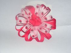 Ld. dbl layered  flower bow with ribbon knot center.  - $5