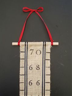 DIY Growth Chart.  I've been looking for a natural look that I make with fabric and stamps. I think this fits the bill!
