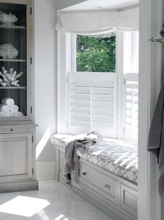 White and gray window seat with roman shades, shutters and beautiful cushion.  Not to mention, storage under the seat.  #windowseat