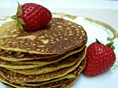 """Grain Free Pumpkin Pancakes - At first glance, the short ingredient list appears to lack a rather key ingredient of pancakes: flour. With the term """"grain free"""" in the title, you probably expect the recipe to call for pricey coconut or almond flour. Instead, eggs and pumpkin puree work as a binder in these pancakes."""