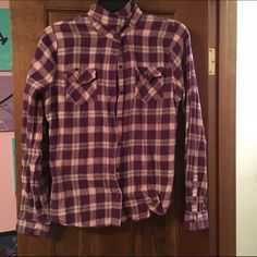 Cute Long Sleeve Purple Flannel! This was bought from Target in October! I only wore it once for my schools spirit week. It is in great condition- no stains, tears or rips! There are pockets on both sides of the chest, and buttons around the hand cuffs! Mossimo Supply Co Tops Tees - Long Sleeve