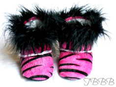 Hot Pink Zebra baby crib boot with  black feathers.