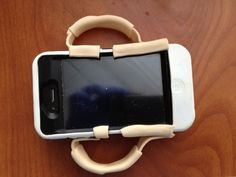 Smart phone holder for hands with sensory loss and incoordination- made with splinting scrap materials.  Outreach Therapy Consultants