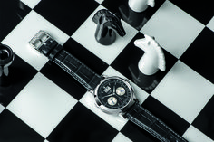 A Lange Sohne Datograph Up Down on black and white chess board