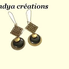 Paire de boucles d'oreilles perles noir et bronze