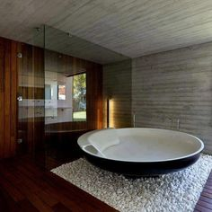unique tub surrounded by a clean, classy bathroom