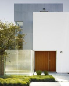 """Archinect on Instagram: """"1/3: Zeidler Residence by Ehrlich Yanai Rhee Chaney Architects @eyrcarchitects Photo: Matthew Millman @matthewmillmanphoto More images and…"""" Contemporary Front Doors, Contemporary Interior, Residential Architecture, Garage Doors, Exterior, Architects, Lighting, Building, Outdoor Decor"""