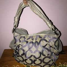 Authentic coach signature bag gray & purple Authentic Coach signature bag gray & purple size  11 1/2 wide 10 inches tall grey twisted leather handle 2 side pockets inside gray material one big pocket 2 smaller pockets snap closure great shape 10 inches from middle of strap to the top of the purse 👛 Coach Bags Hobos