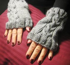 Chunky cable knit wristlets.