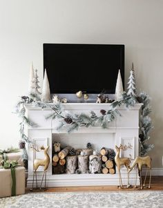 Fill up your faux fireplace with whimsical holiday decorations like pine cones + woodland creatures.