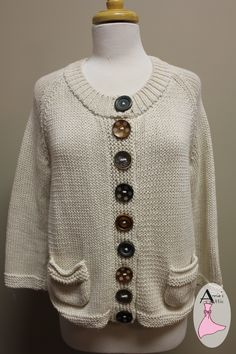 Long sleeve Pure cardigan, size M/L 100% cotton Fastens with wooden buttons displaying unique designs Two pockets on the front