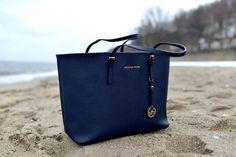 Dark blue handbag by Michael Kors.