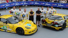 Corvette Racing drivers pose for photo at the  90th 24 Hours of Le Mans.